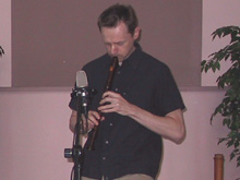 Cornell Kinderknecht playing recorder at Malvina's Coffeehouse, Carrollton, Texas
