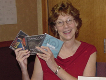 Suzy Hogue at the CD table. November 18, 2005, Armadillo Flute Society Retreat, Flower Mound, Texas